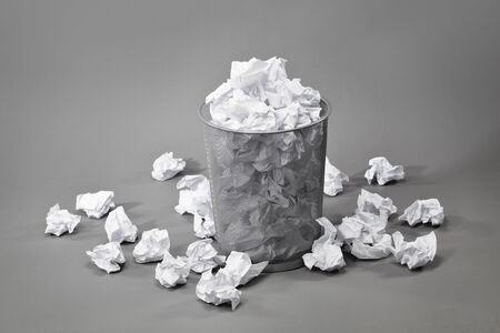 trashcan: A trashcan filled with crumpled white papers Stock Photo