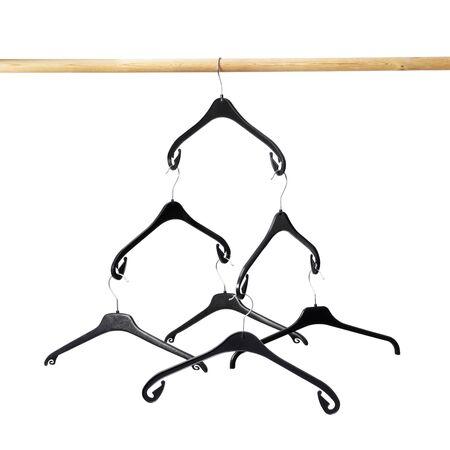 Empty black plastic clothes hangers hanging photo