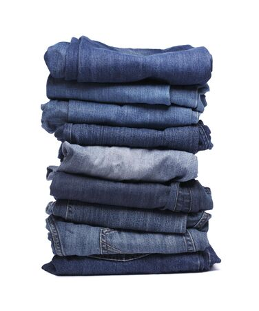 heap: Stack of blue jeans pants isolated on white with natural shadows Stock Photo