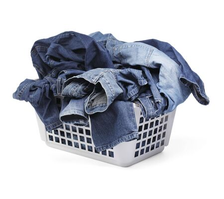 laundry basket: A Laundy basket filled with only jeans. Isolated on white with natural shadows.