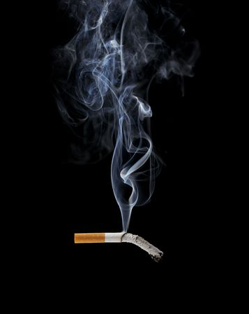 cigarette: A Smoking cigarette on black background