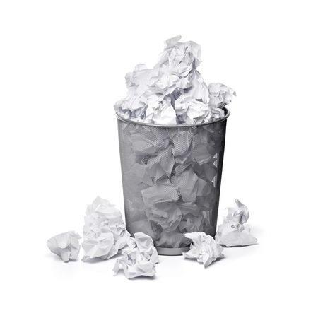 trashed: A trashcan full of crumpled paper Stock Photo
