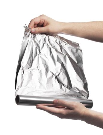 Man holding a roll of household aluminum foil photo