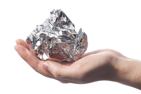 Hand holding a crumpled aluminum foil wrap Stock Photo - 6914165