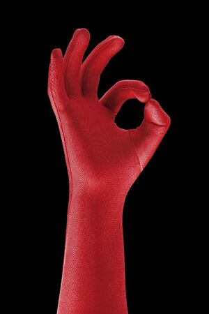 a strange red gloved hand doing OK sign Stock Photo - 6914153