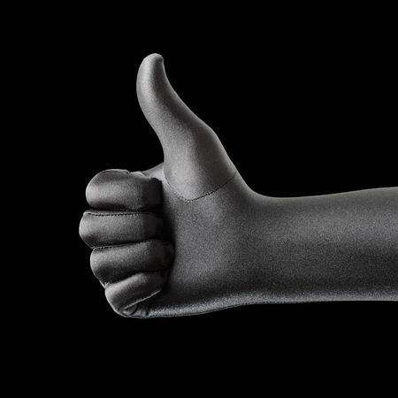 A Strange black gloved hand doing thumb up gesture Stock Photo - 6914147