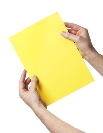 Man holding a yellow paper Stock Photo - 6914155