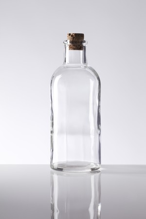 closed corks: Old fashioned glass bottle with a cork stopper