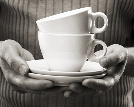 Man holding coffee cups in his hands. photo