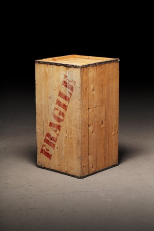Mysterious old wooden crate with word
