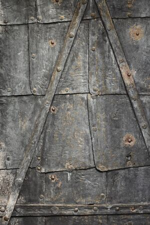Texture of an old rusty and weathered iron door. photo