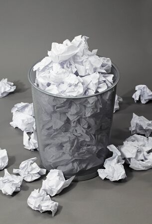 wastepaper basket: A full wastepaper basket. Note: The background may appear noisy, but that is just the background material! Stock Photo