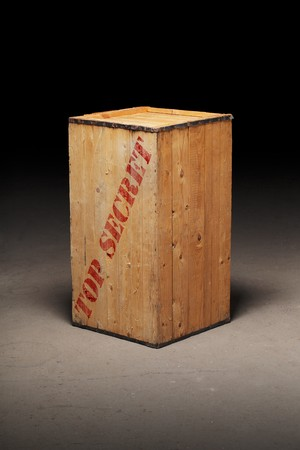 secrets: Old wooden crate with text Top Secret on dirty concrete floor.