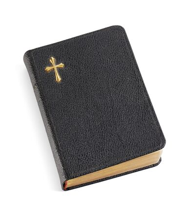 holy bibles: An old pocket-sized black bible isolated on white eith natural shadows