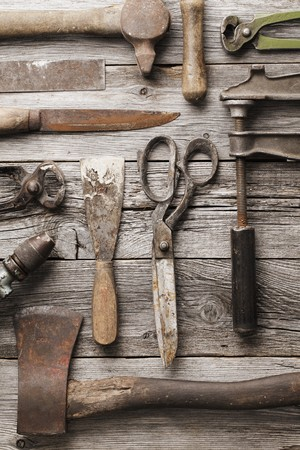 Old rusty tools on wooden background