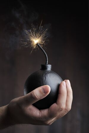Man holding a bomb in his hand Stock Photo - 7917315