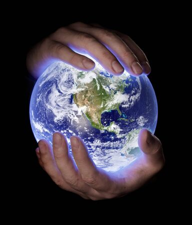 Man holding a glowing earth globe in his hands. Earth image provided by Nasa. Stock Photo - 7917284