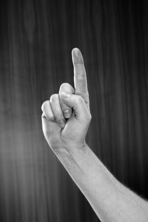 Black and white image of man pointing with his index finger Stock Photo - 7917285