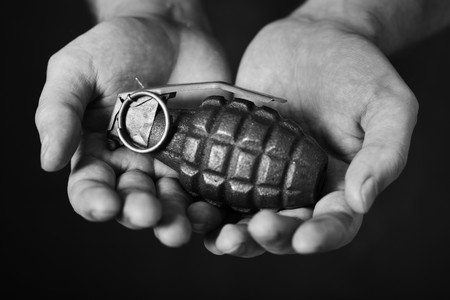 Man holding an old hand grenade in his hands Stock Photo - 7917316