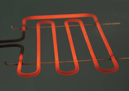 resistance: Heating element of a small electrig barbeque grill glowing. Stock Photo