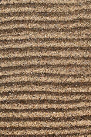 coarse: Horizontal lines drawn into coarse sea sand. Stock Photo