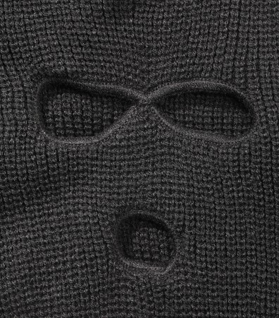 ski mask: Detail of a Black ski mask aka Balaclava isolated on white with natural shadows.