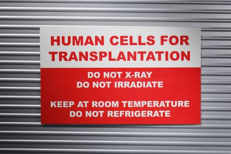 transplants: Human Cells for Transplantation information sticker. Short depth-of-field. Stock Photo