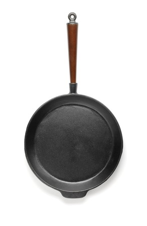 frying pan: Old fashioned cast iron frying pan isolated on white with natural shadows. Stock Photo