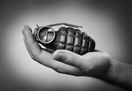 handgrenade: Man holding a hand grenade on his hand.