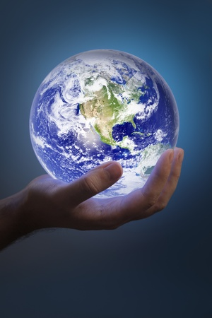 Man holding a glowing earth in his hand. Earth image provided by NASA. Stock Photo - 8518750