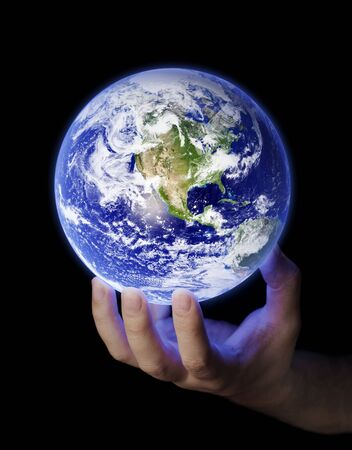 hands holding earth: Man holding a glowing earth in his hand. Earth image provided by NASA.