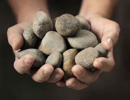 rocks: Man holding different small rocks in his hands Stock Photo