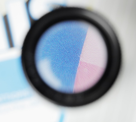 stochastic: Stochastic offset printing raster seen trough a loupe.