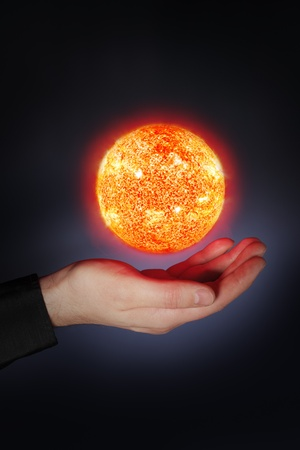A Glowing floaing above a hand. Sun images provided by NASA. Stock Photo - 9410781