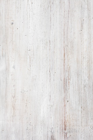 Worn, scratched and dirty wood painted white. photo
