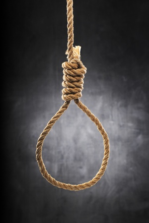 capital punishment: Old rope with hangmans noose. Stock Photo
