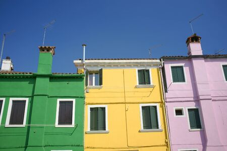 Burano is situated 7 kilometers from Venice. Burano is known for its small, brightly-painted houses. Stock Photo - 9898245