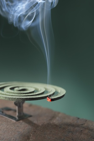 usually: Mosquito coil is mosquito-repelling incense, usually shaped into a spiral, and typically made from a dried paste of pyrethrum  powder.