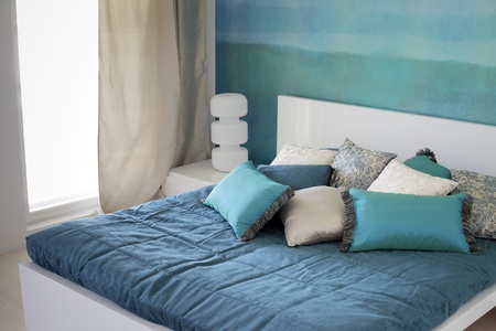 Modern Bedroom, bed with cushions. Stock Photo - 10104197