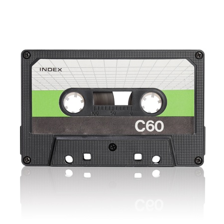 analogs: Vintage c-cassette audio tape on white with natural reflection. Stock Photo