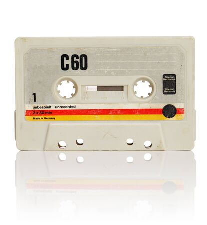 Vintage compact cassette audio tape on white with natural reflection. Stock Photo - 10422061