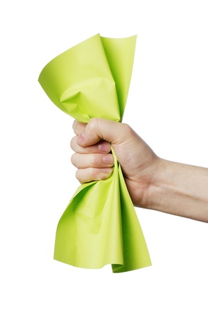 scrunch: Man holding a crumpled green paper in his hand.