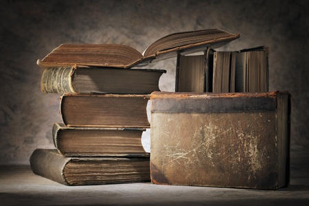 stacked books: Still life made of old worn books. Stock Photo