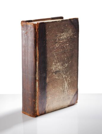 book spine: Old antique worn and tattered book.