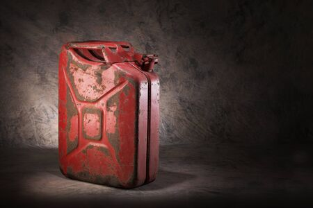 petrol can: Old, dirty and rusty red jerry can fuel container.