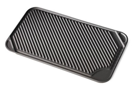 stovetop: Stovetop grill pan with non-stick ceramic surface isolated on white with natural shadows. Stock Photo