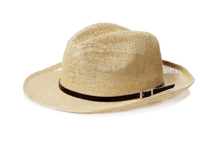 cheap: A Cheap summer hat made of straw on white background with natural reflection.