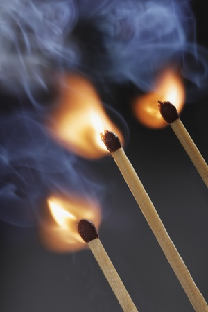 igniting: Three safety matches igniting simultaneosly