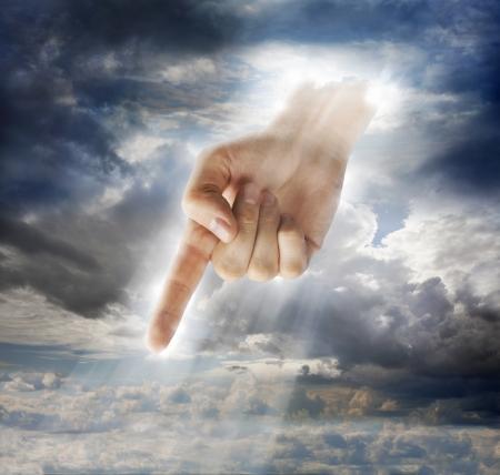 interventie: Hand van een god-achtig wezen wijst met vinger. Stockfoto
