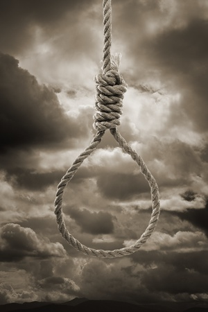 penalty: Sepia toned photograph of a hangmans Noose against cloudy sky.